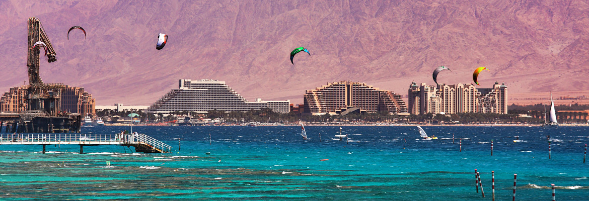 Panoramic view on coastline with hotels, mountains and bay of Eilat located on Red Sea in Israel.